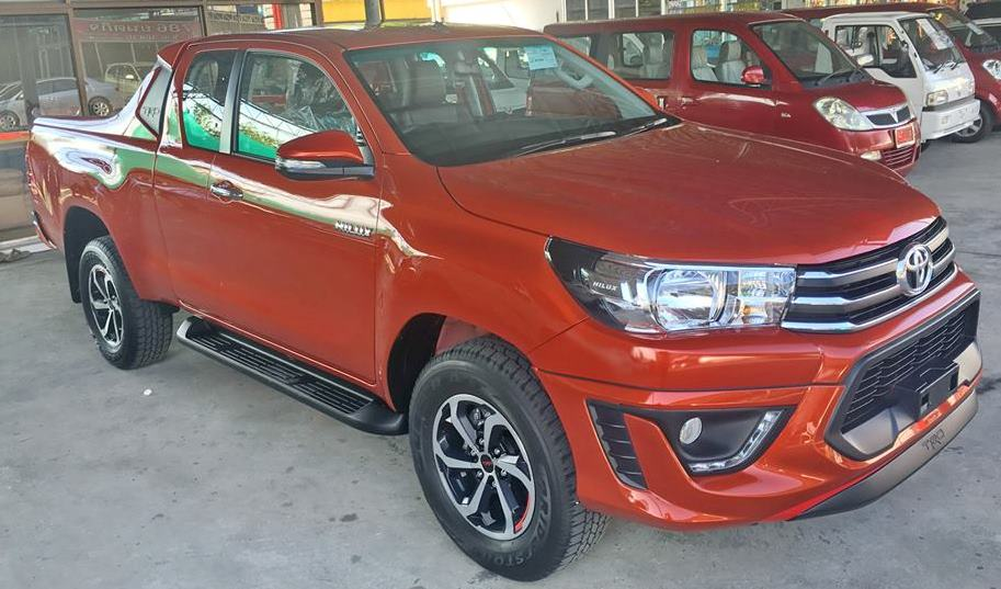 2016-Toyota-Hilux-Revo-TRD-Smart-Cab-Orange-front-side